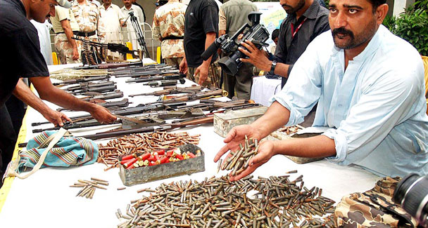 Security officials display arms siezed during an operation in Lyari, Karachil —ONLINE/File photo